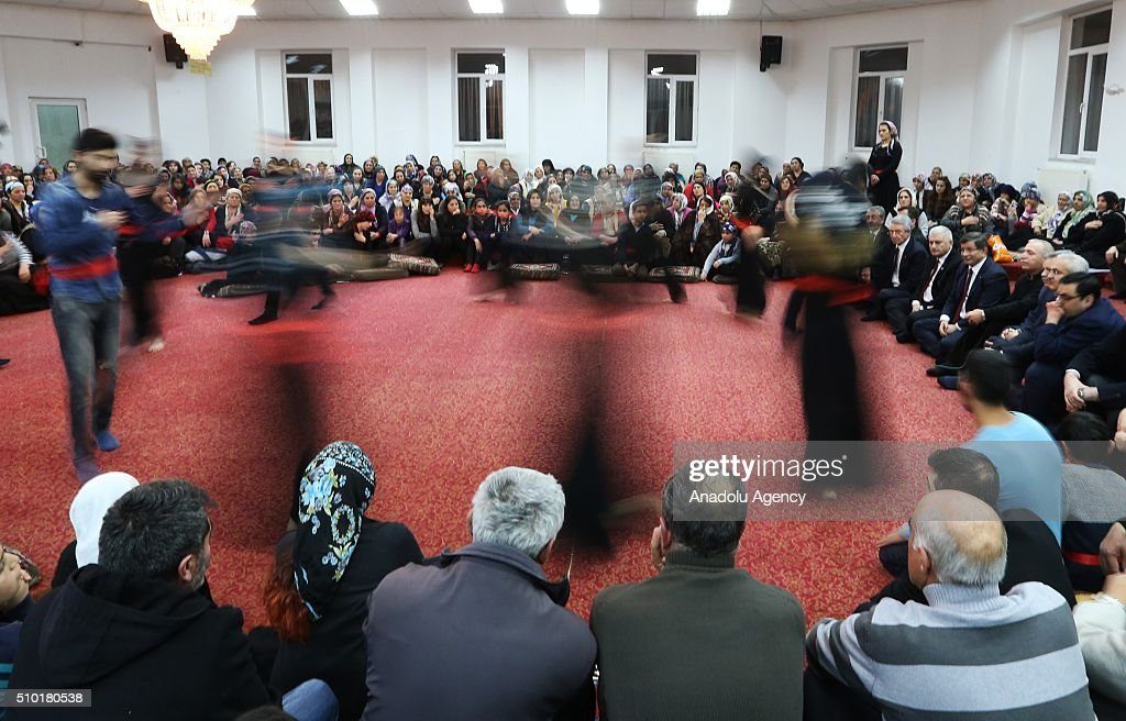 Prime Minister of Turkey, Ahmet Davutoglu (4th R) attend a 'Semah' prayer mass as he visits Haci Bektai Veli Anadolu Cultural Foundation where also hosts a 'Cemevi' in Erzincan, Turkey on February 14, 2016. Cemevi is a holy place where Alawites, a branch of Islam, gathers and pray.
