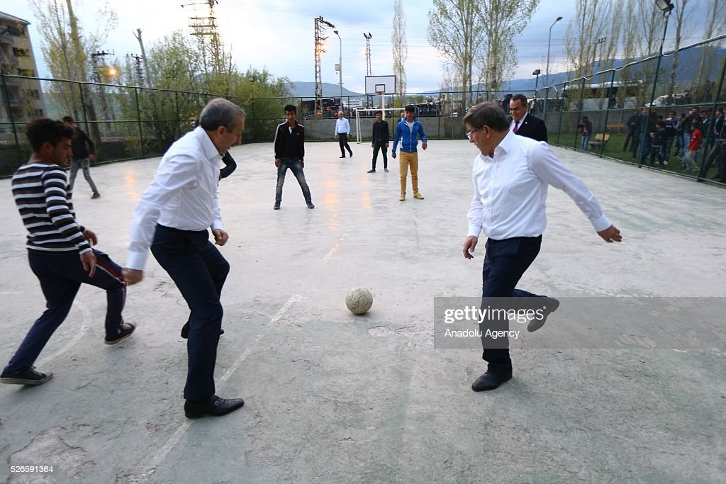 Prime Minister of Turkey, Ahmet Davutoglu plays football with children at schoolyard in Varto district of Turkey's Mus, on April 30, 2016.
