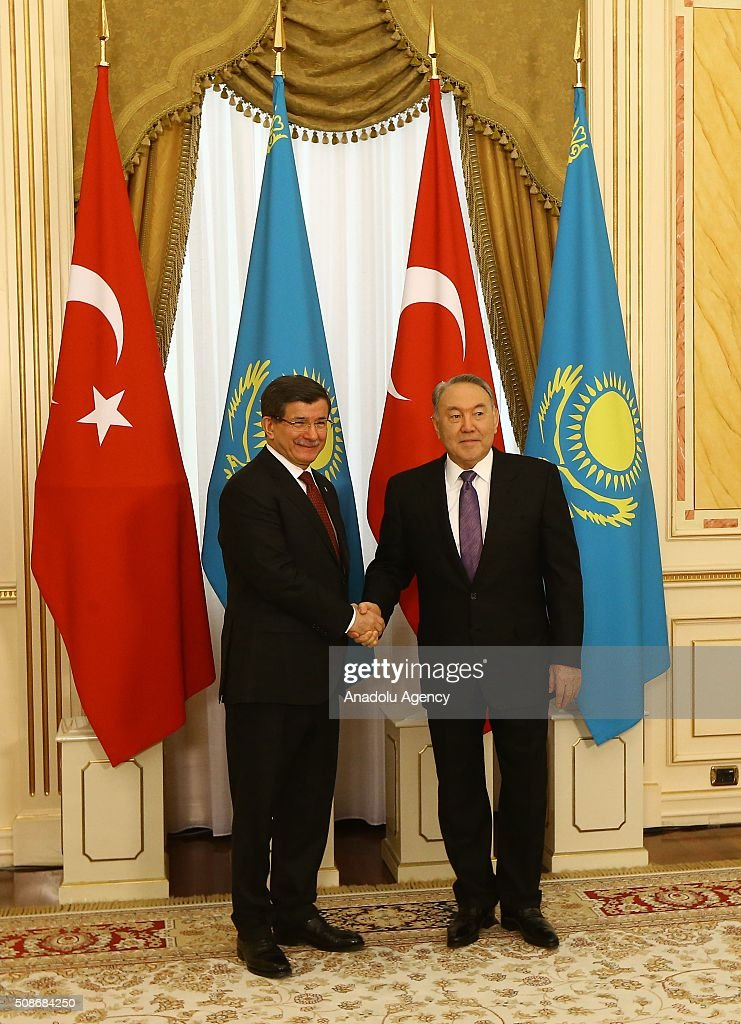 Prime Minister of Turkey Ahmet Davutoglu (L) shakes hand with President of Kazakhstan Nursultan Nazarbayev prior to their meeting in Astana, Kazakhstan on February 6, 2016.