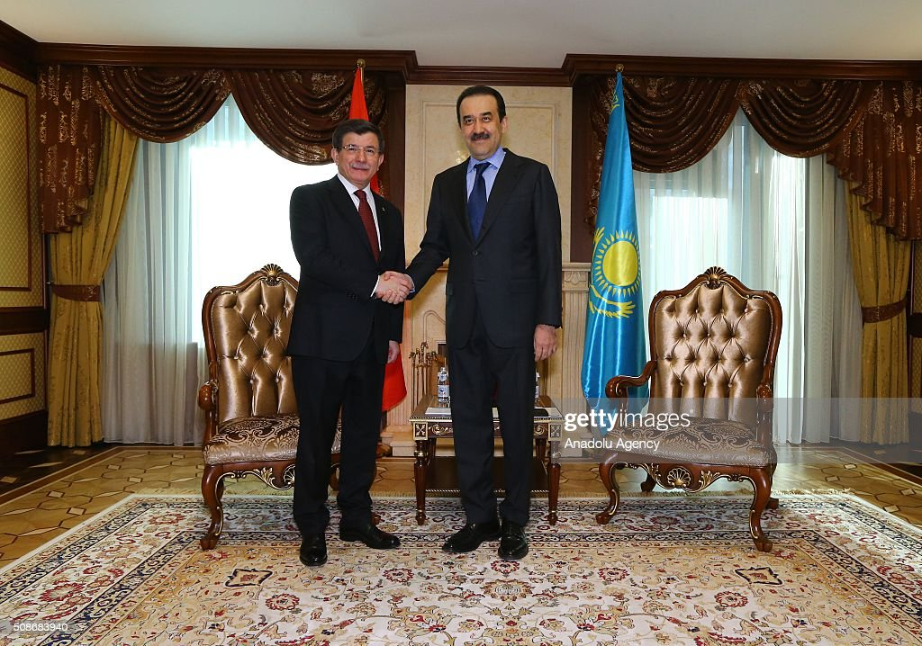 Prime Minister of Turkey Ahmet Davutoglu (L) shakes hand with Prime Minister of Kazakhstan Karim Massimov prior to their meeting in Astana, Kazakhstan on February 6, 2016.