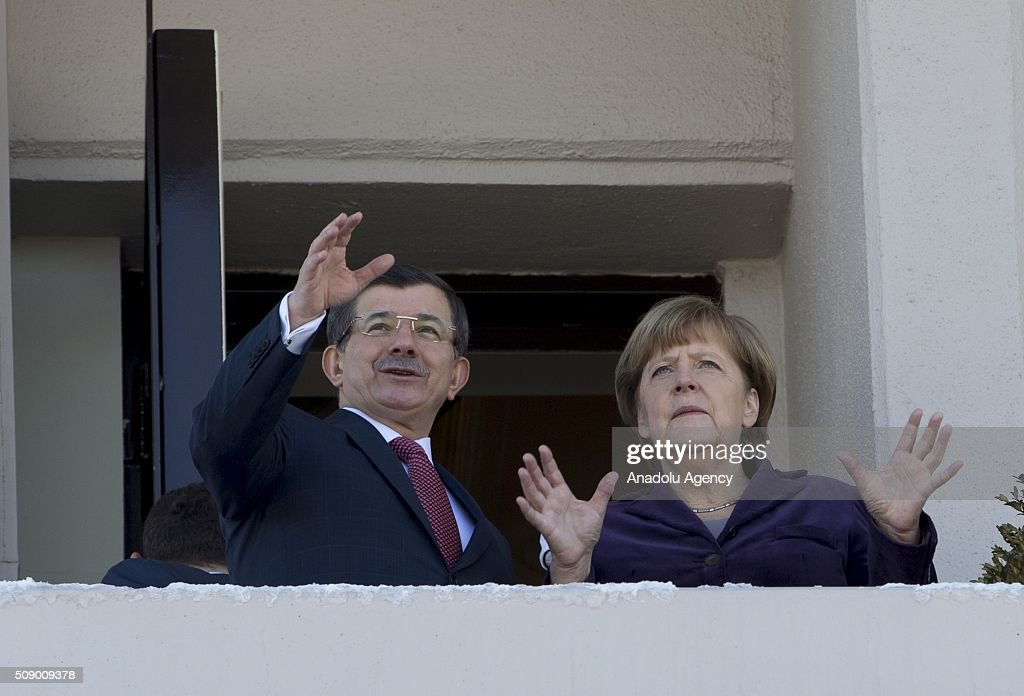 Prime Minister of Turkey Ahmet Davutoglu (L) speaks with German Chancellor Angela Merkel (R at the balcony of Cankaya Palace in Ankara, Turkey on February 8, 2016.