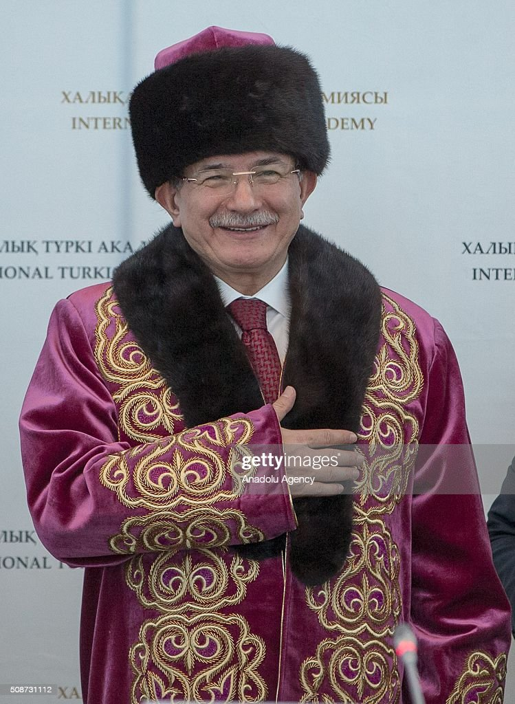Prime Minister of Turkey Ahmet Davutoglu wearing traditional kazakhistani clothes greets during the conference organized by Turkish academy at Peace and Reconciliation Palace in Astana, Kazakhstan on February 6, 2016.