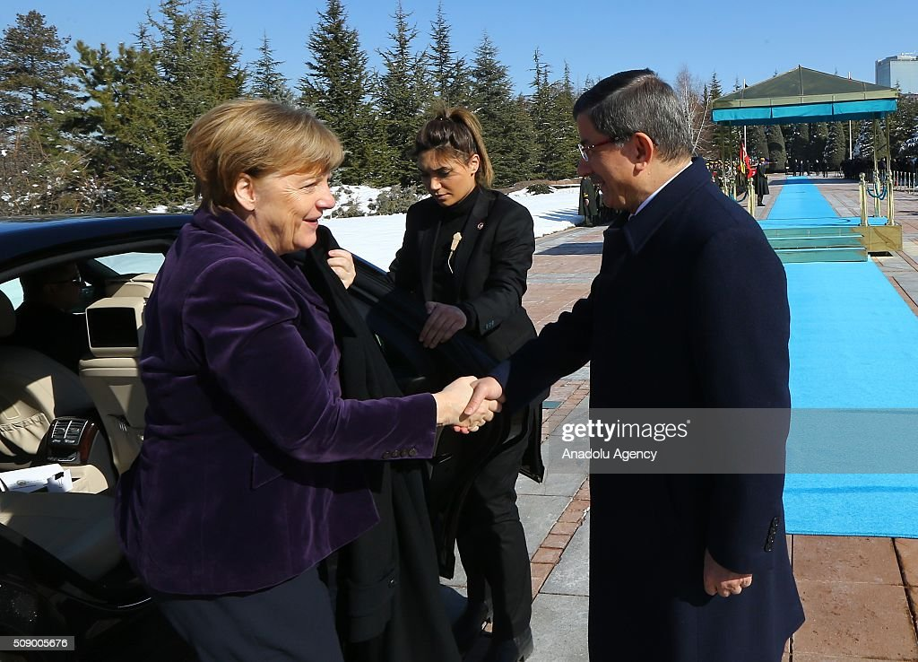 Prime Minister of Turkey Ahmet Davutoglu (R) welcomes German Chancellor Angela Merkel during the official welcoming ceremony in Ankara, Turkey on February 8, 2016.