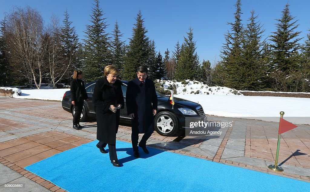 Prime Minister of Turkey Ahmet Davutoglu (R) welcomes German Chancellor Angela Merkel (L) during the official welcoming ceremony in Ankara, Turkey on February 8, 2016.