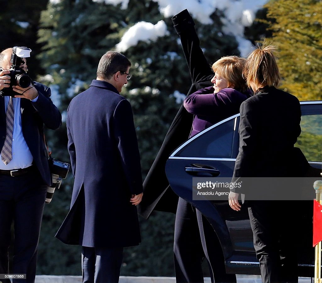 Prime Minister of Turkey Ahmet Davutoglu (C) welcomes German Chancellor Angela Merkel as she visits Ankara, Turkey on February 8, 2016.