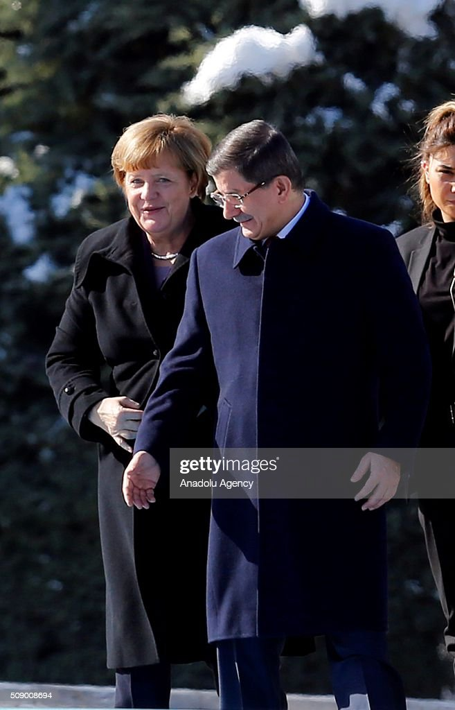 Prime Minister of Turkey Ahmet Davutoglu (C) welcomes German Chancellor Angela Merkel (L) as she visits Ankara, Turkey on February 8, 2016.
