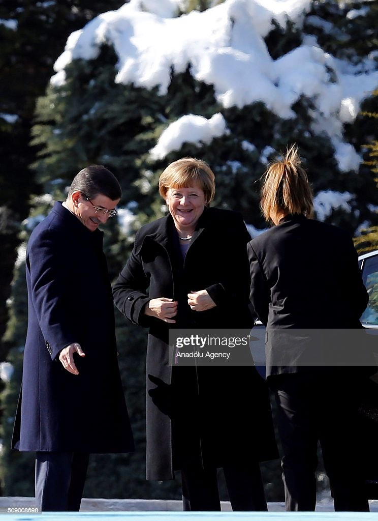 Prime Minister of Turkey Ahmet Davutoglu (L) welcomes German Chancellor Angela Merkel (C) as she visits Ankara, Turkey on February 8, 2016.