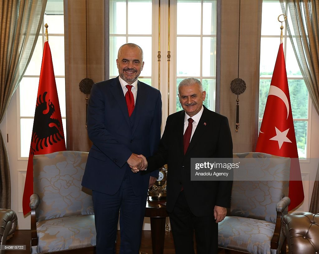 Prime Minister of Turkey, Binali Yildirim (L) and Albanian Prime Minister Edi Rama (2nd L) shake hands before their meeting at Cankaya Palace in Ankara, Turkey on June 29, 2016.