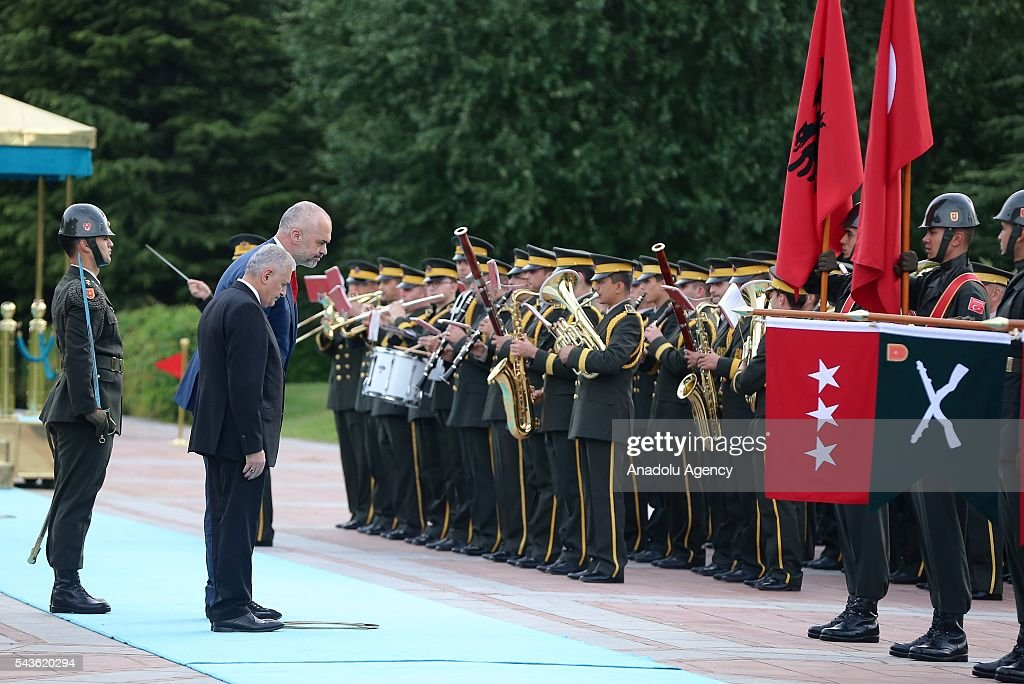 Prime Minister of Turkey, Binali Yildirim (2nd L) and Albanian Prime Minister Edi Rama (3rd L) salute honor guards during a welcoming ceremony at Cankaya Palace in Ankara, Turkey on June 29, 2016.