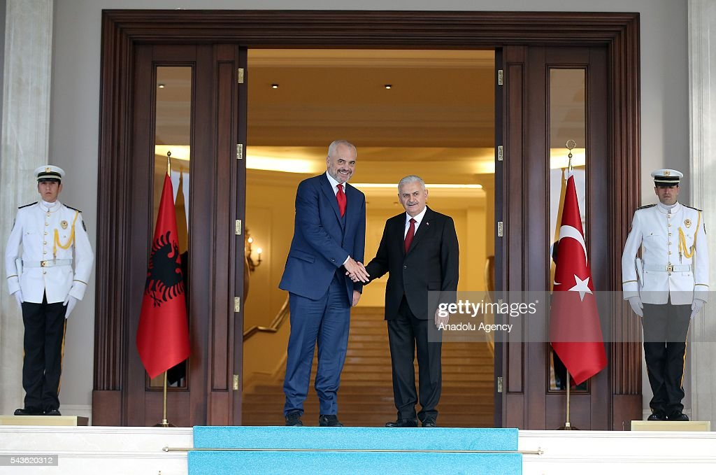 Prime Minister of Turkey, Binali Yildirim (L) and Albanian Prime Minister Edi Rama (2nd L) shake hands during a welcoming ceremony at Cankaya Palace in Ankara, Turkey on June 29, 2016.