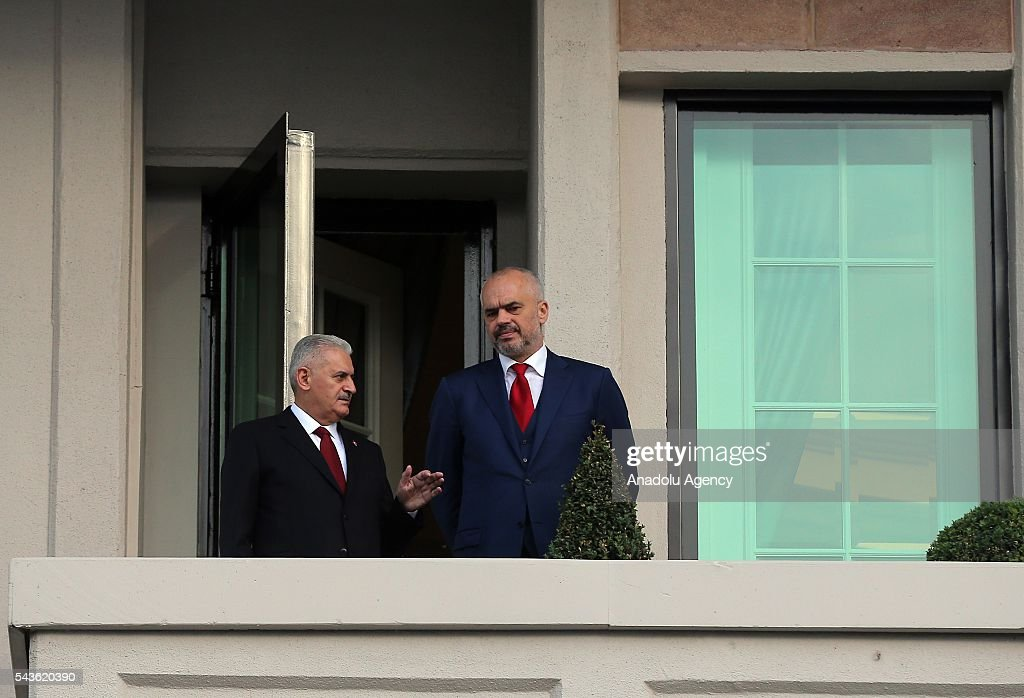 Prime Minister of Turkey, Binali Yildirim (L) and Albanian Prime Minister Edi Rama (R) have a conversation as they watch the cityscape at the balcony of Cankaya Palace in Ankara, Turkey on June 29, 2016 during a meeting.