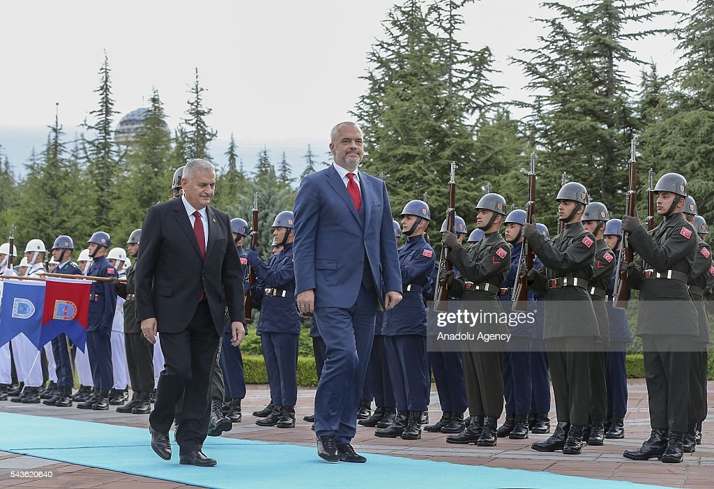 Prime Minister of Turkey, Binali Yildirim (L) and Albanian Prime Minister Edi Rama (R) salute honor guards during a welcoming ceremony at Cankaya Palace in Ankara, Turkey on June 29, 2016.