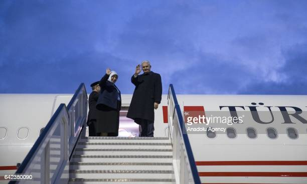 Prime Minister of Turkey Binali Yildirim and his wife Semiha Yildirim wave hands at the door of the official plane heading to Germany after they...
