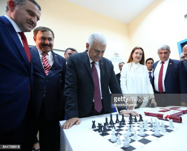 Prime Minister of Turkey Binali Yildirim and Turkish Youth and Sports Minister Osman Askin Bak inspect the works after the opening ceremony of Buca...