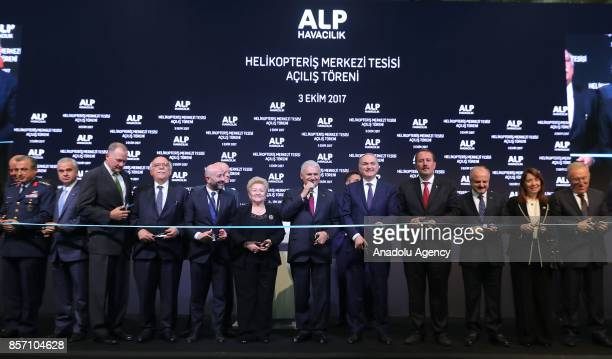 Prime Minister of Turkey Binali Yildirim delivers a speech before cutting the ribbon during the opening ceremony of Alp Aviation at Chamber of...