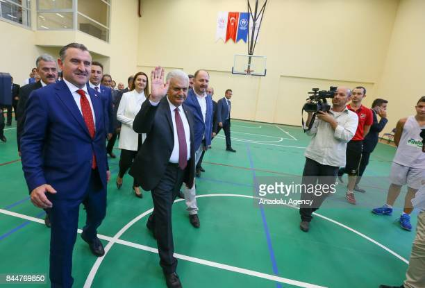 Prime Minister of Turkey Binali Yildirim greets the crowd after the opening ceremony of Buca Yasin Boru Youth Centre and groundbreaking ceremony of...
