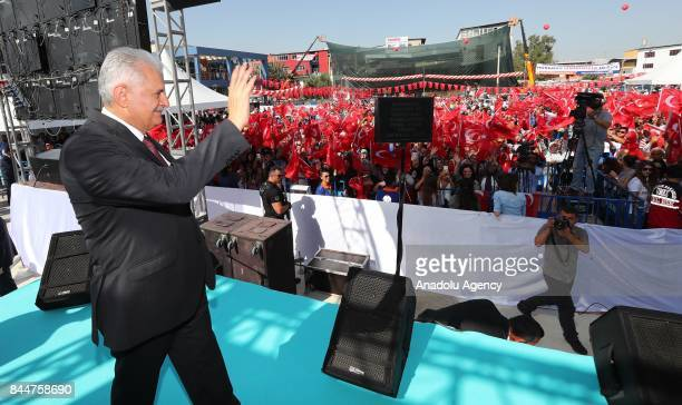Prime Minister of Turkey Binali Yildirim greets the crowd as he attends the opening ceremony of Buca Yasin Boru Youth Centre and groundbreaking...