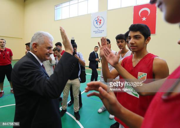 Prime Minister of Turkey Binali Yildirim greets the young players during the opening ceremony of Buca Yasin Boru Youth Centre and groundbreaking...