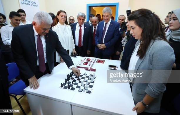 Prime Minister of Turkey Binali Yildirim inspects the works after the opening ceremony of Buca Yasin Boru Youth Centre and groundbreaking ceremony of...