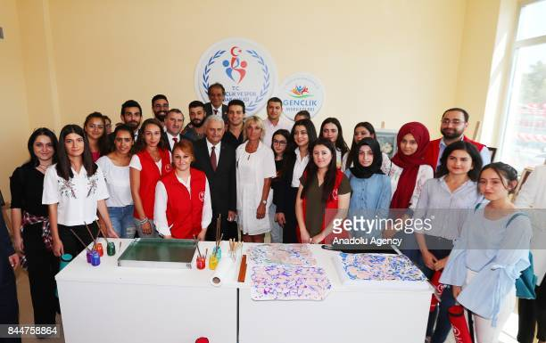 Prime Minister of Turkey Binali Yildirim poses for a photo after inspecting the works following the opening ceremony of Buca Yasin Boru Youth Centre...