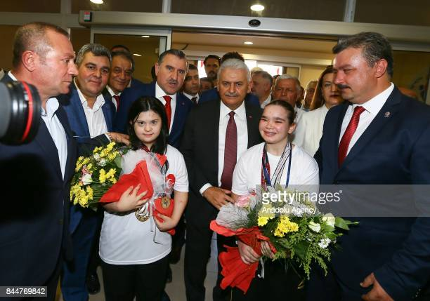 Prime Minister of Turkey Binali Yildirim poses for a photo after the opening ceremony of Buca Yasin Boru Youth Centre and groundbreaking ceremony of...