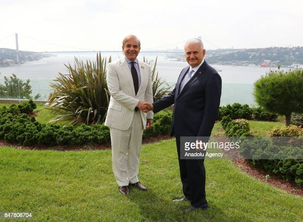 Prime Minister of Turkey Binali Yildirim shakes hands with Pakistani Chief Minister of Punjab Shehbaz Sharif as they pose for a photo at Vahdettin...
