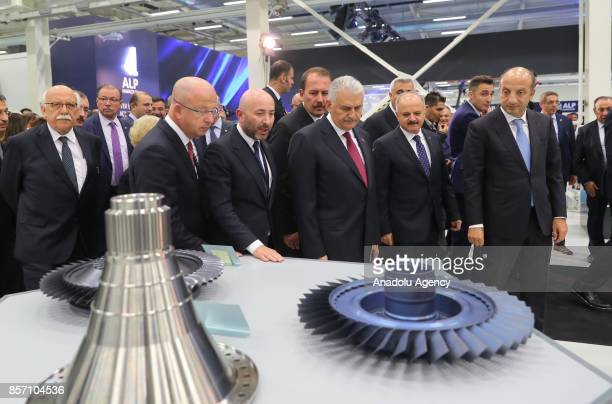 Prime Minister of Turkey Binali Yildirim tours the facility after the opening ceremony of Alp Aviation at Chamber of Industry Organized Industrial...