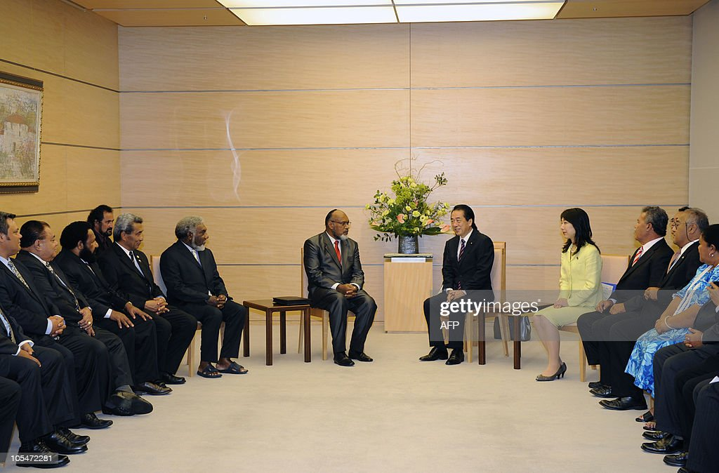 Prime Minister of Vanuatu and Chairman of the Pacific Islands Forum (PIF) <a gi-track='captionPersonalityLinkClicked' href=/galleries/search?phrase=Edward+Natapei&family=editorial&specificpeople=3057010 ng-click='$event.stopPropagation()'>Edward Natapei</a> (CL) meets Japanese Prime Minister <a gi-track='captionPersonalityLinkClicked' href=/galleries/search?phrase=Naoto+Kan&family=editorial&specificpeople=697761 ng-click='$event.stopPropagation()'>Naoto Kan</a> (CR) at the prime minister's official residence in Tokyo on October 15, 2010. Natapei leads a delegation of foreign ministers or equivalent from 14 member countries and 2 regions of the PIF during their visit to Japan.