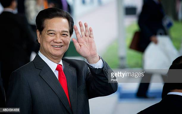 Prime Minister of Vietnam Nguyen Tan Dung departs at the conclusion of the 2014 Nuclear Security Summit on March 25 2014 in The Hague Netherlands...
