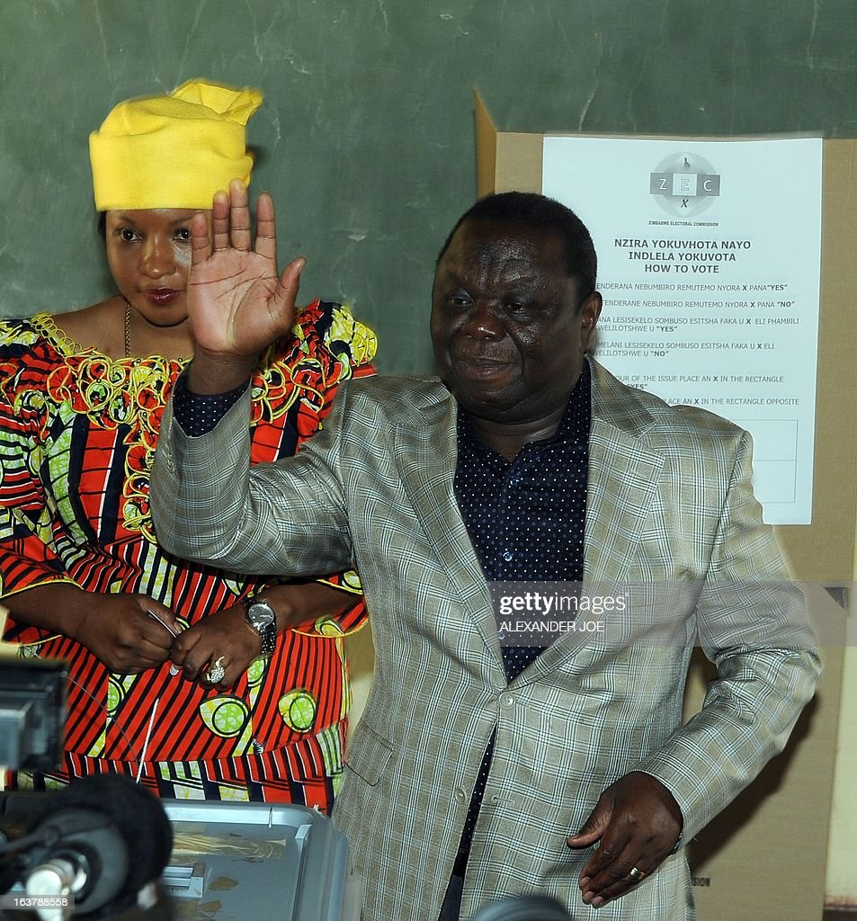 Prime Minister of Zimbabwe Morgan Tsvangirai waves after casting his vote in Saint-Marys on March 16, 2013, as voting kicked off for Zimbabweans referendum to adopt a new charter to pave way for new elections and a possible end to a shaky power-sharing government.