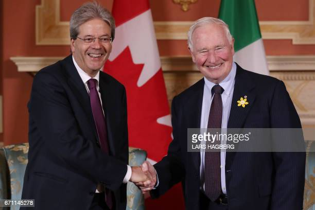 Prime Minister Paolo Gentiloni of Italy shakes hands with Governor General David Johnston at the Rideau hall in Ottawa Ontario April 21 2017 / AFP...