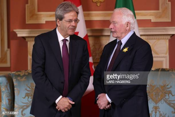 Prime Minister Paolo Gentiloni of Italy speaks with Governor General David Johnston at the Rideau hall in Ottawa Ontario April 21 2017 / AFP PHOTO /...