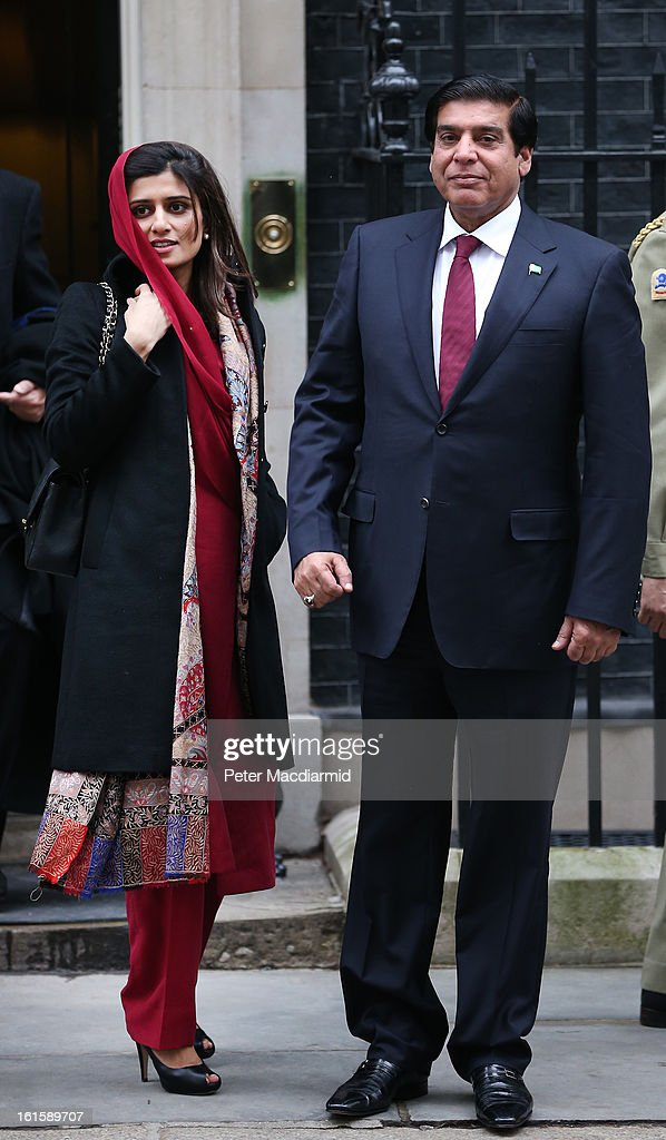 Prime Minister Raja Pervez Ashraf of Pakistan leaves 10 Downing Street with Pakistani Foreign Minister <a gi-track='captionPersonalityLinkClicked' href=/galleries/search?phrase=Hina+Rabbani+Khar&family=editorial&specificpeople=781486 ng-click='$event.stopPropagation()'>Hina Rabbani Khar</a> (L) after meeting with Prime Minister David Cameron on February 12, 2013 in London, England. Mr Ashraf is in the United Kingdom on a four day visit.
