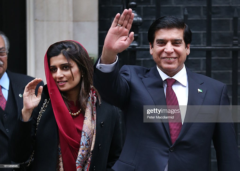Prime Minister Raja Pervez Ashraf of Pakistan waves to reporters as he leaves 10 Downing Street with Pakistani Foreign Minister <a gi-track='captionPersonalityLinkClicked' href=/galleries/search?phrase=Hina+Rabbani+Khar&family=editorial&specificpeople=781486 ng-click='$event.stopPropagation()'>Hina Rabbani Khar</a> (L) after meeting with Prime Minister David Cameron on February 12, 2013 in London, England. Mr Ashraf is in the United Kingdom on a four day visit.