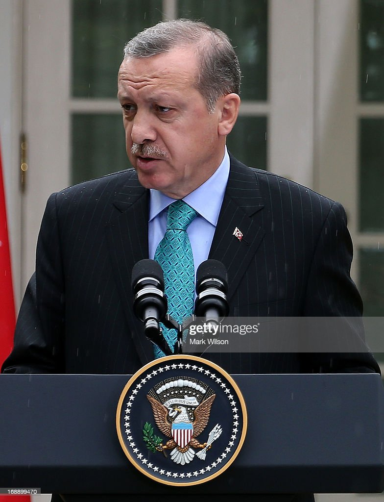 Prime Minister <a gi-track='captionPersonalityLinkClicked' href=/galleries/search?phrase=Recep+Tayyip+Erdogan&family=editorial&specificpeople=213890 ng-click='$event.stopPropagation()'>Recep Tayyip Erdogan</a> of Turkey speaks to the media during a news conference with U.S. President Barack Obama in the Rose Garden at the White House May 16, 2013 in Washington, DC. President Obama answered questions on the IRS Justice Department invesigation and the two leaders spoke about the fighting in Syria.