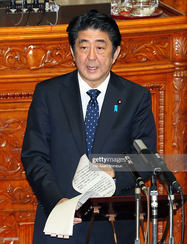 Prime Minister <a gi-track='captionPersonalityLinkClicked' href=/galleries/search?phrase=Shinzo+Abe&family=editorial&specificpeople=559017 ng-click='$event.stopPropagation()'>Shinzo Abe</a> addresses at the plenary session of the upper house on November 27, 2013 in Tokyo, Japan. The bill was rammed through the Lower House yesterday despite widespread criticism that its vague wording could lead to arbitrary designations of information as 'secret' and scare off journalists and whistle-blowers, no under discussion at the upper house.