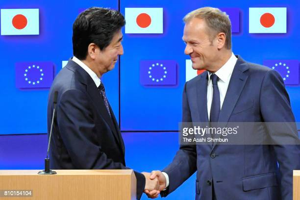 Prime Minister Shinzo Abe and European Council President Donald Tusk shake hands during a press conference following the EUJapan Summit on July 6...