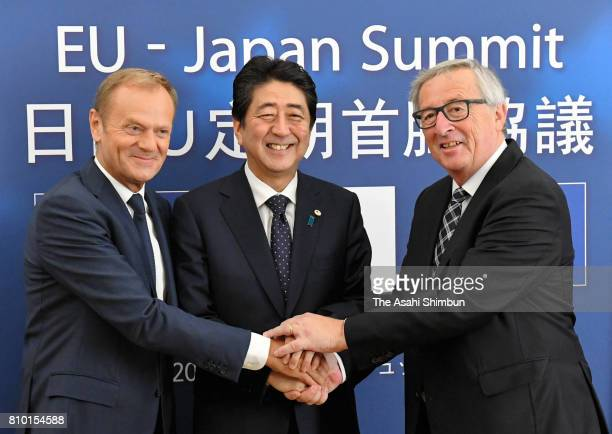 Prime Minister Shinzo Abe and European Council President Donald Tusk and European Commission President JeanClaude Junker shake hands prior to the...