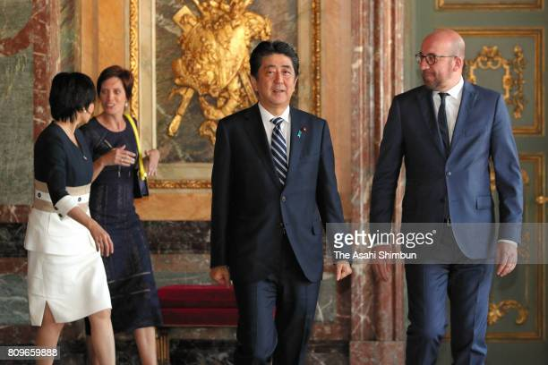 Prime Minister Shinzo Abe and his wife Akie walk with Belgium Prime Minister Charles Michel and his partner Amelie Derbaudrenghien prior to their...