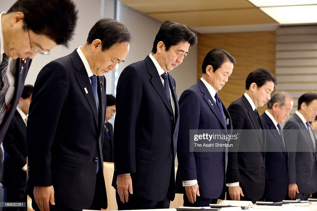 Prime Minister <a gi-track='captionPersonalityLinkClicked' href=/galleries/search?phrase=Shinzo+Abe&family=editorial&specificpeople=559017 ng-click='$event.stopPropagation()'>Shinzo Abe</a> (3L) and ministers offer silent prayer prior to an emergency meeting on the Algerian hostage crisis at Abe's official residence on January 25, 2013 in Tokyo, Japan. A Japanese government aircraft lands at Tokyo International Airport on January 25, 2013 in Tokyo, Japan. The aircrafts carrys the seven survivors and the bodies of nine victims of the Algerian hostage crisis.