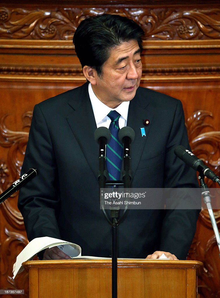 Prime Minister <a gi-track='captionPersonalityLinkClicked' href=/galleries/search?phrase=Shinzo+Abe&family=editorial&specificpeople=559017 ng-click='$event.stopPropagation()'>Shinzo Abe</a> answers a question concerning the state secrets protection bill during a Lower House session at the Diet building on November 7, 2013 in Tokyo, Japan. In a plenary session, the Lower House started deliberations on the state secrets protection bill, which will toughen penalties on public servants who leak 'specified secrets' that could jeopardize Japan's national security. Under the bill, public servants and other individuals can be imprisoned for up to 10 years if they disclose specified secrets.