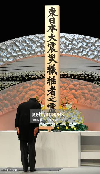 Prime Minister Shinzo Abe bows toward an altar during the memorial ceremony on the sixth anniversary of the Great East Japan Earthquake and following...