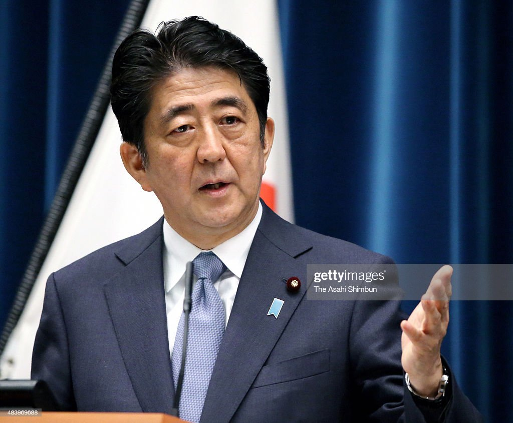Prime Minister Shinzo Abe discusses his statement marking the 70th anniversary of the end of World War II at a press conference at his official...