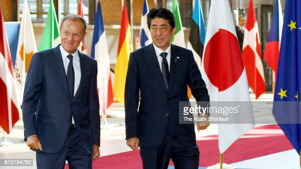 Prime Minister Shinzo Abe is escorted by European Council President Donald Tusk on arrival at the EU headquarters prior to the EUJapan Summit on July...