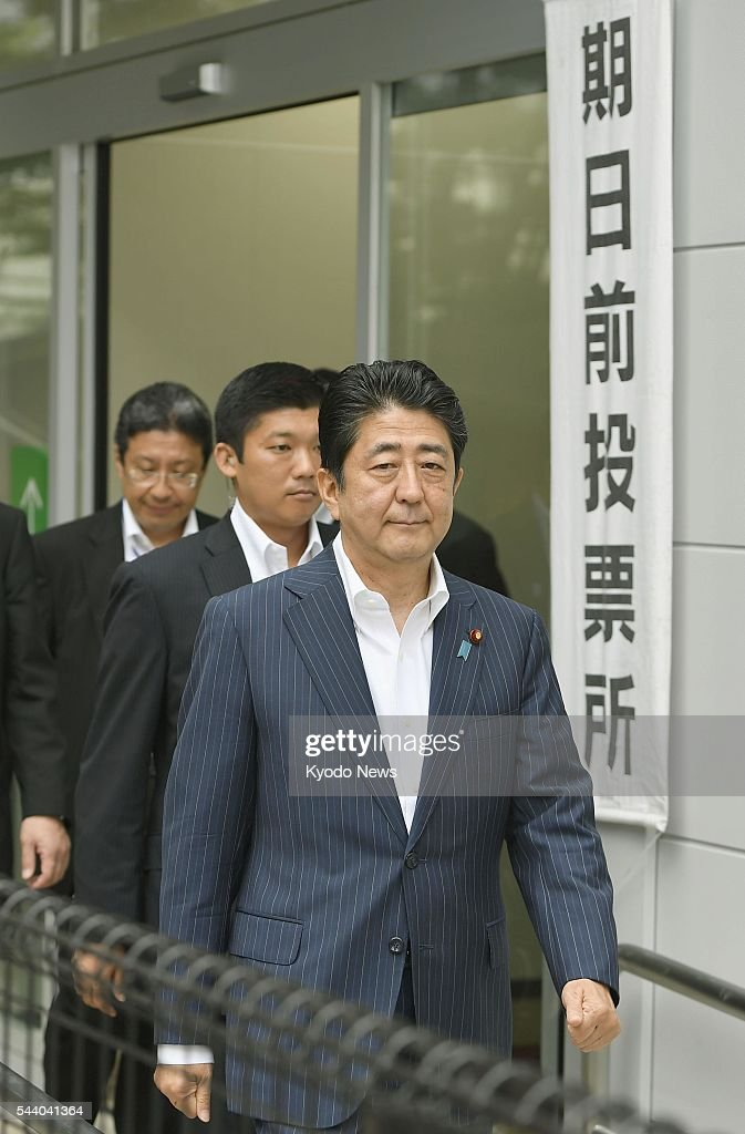 Prime Minister <a gi-track='captionPersonalityLinkClicked' href=/galleries/search?phrase=Shinzo+Abe&family=editorial&specificpeople=559017 ng-click='$event.stopPropagation()'>Shinzo Abe</a> (front) leaves a polling station in Tokyo on July 1, 2016, after casting an absentee ballot for the July 10 House of Councillors election.