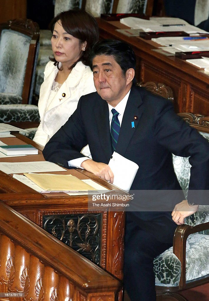 Prime Minister <a gi-track='captionPersonalityLinkClicked' href=/galleries/search?phrase=Shinzo+Abe&family=editorial&specificpeople=559017 ng-click='$event.stopPropagation()'>Shinzo Abe</a> listens a question concerning the state secrets protection bill during a Lower House session at the Diet building on November 7, 2013 in Tokyo, Japan. In a plenary session, the Lower House started deliberations on the state secrets protection bill, which will toughen penalties on public servants who leak 'specified secrets' that could jeopardize Japan's national security. Under the bill, public servants and other individuals can be imprisoned for up to 10 years if they disclose specified secrets.