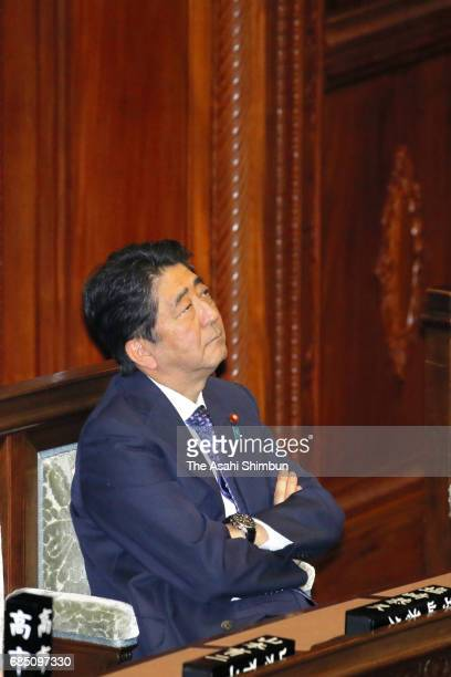 Prime Minister Shinzo Abe listens to deliberation of the noconfidence motion against Justice Minister Katsutoshi Kaneda on May 18 2017 in Tokyo Japan