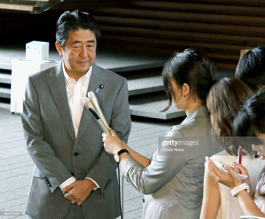 Prime Minister Shinzo Abe meets with reporters at his office in Tokyo on Aug 24 saying North Korea's missile launch poses grave threat to Japan's...