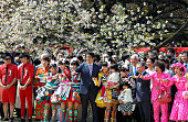 Prime Minister Shinzo Abe poses for photographs with guests during the cherry blossoms viewing party hosted by Abe at Shinjuku Gyoen Park on April 18...