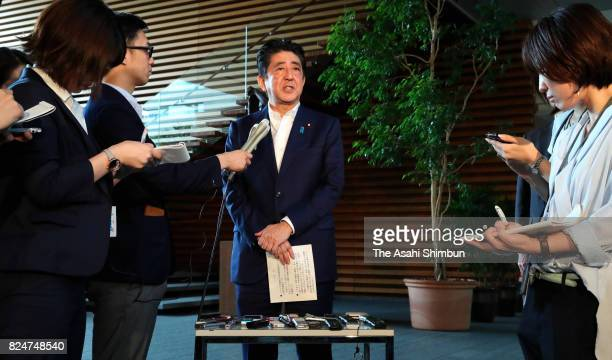 Prime Minister Shinzo Abe responds to questions from reporters after holding telephone talks with US President Donald Trump at his official residence...